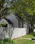 White picket fence with house Colonial Williamsburg Virginia, Williamsburg Virginia 1699 to 1780 capital Commonwealth of Virginia molding democracy for the United States of America.  Williamsburg was the center of government, education and culture in the Colony of Virginia, george Washington, Thomas Jefferson, Patrick Henry, James Monroe, Hames Madison, George Wythe, Peyton Randolph and others molded democracy for the United States,