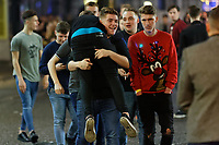 A man carries his friend in Wind Street, Swansea, Wales  on Mad Friday, Booze Black Friday or Black Eye Friday, the last Friday night before Christmas Day, when traditionally people in the UK go out to celebrate the start of their holidays. Friday 22 December 2017