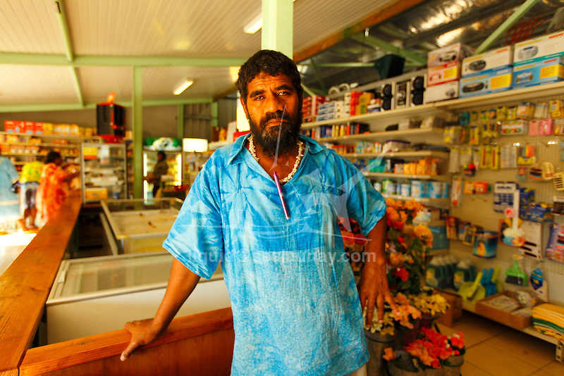 """Local convenience store in the Fayaoue village on the Ouvea island in the Loyalty islands..Ouvéa (local pronunciation: [u've.a]) is a commune in the Loyalty Islands Province of New Caledonia, an overseas territory of France in the Pacific Ocean. The settlement of Fayaoué [fa'jawe], on Ouvéa Island, is the administrative centre of the commune of Ouvéa..Ouvéa is made up of Ouvéa Island, the smaller Mouli Island and Faiava Island, and several islets around these three islands. All these lie among the Loyalty Islands, to the northeast of New Caledonia's mainland..Ouvéa Island is one of the Loyalty Islands, in the archipelago of New Caledonia, an overseas territory of France in the Pacific Ocean. The island is part of the commune (municipality) of Ouvéa, in the Islands Province of New Caledonia..The crescent-shaped island, which belongs to a larger atoll, is 50 km (30 miles) long and 7 km (4.5 miles) wide. It lies northeast of Grande Terre, New Caledonia's mainland..Ouvéa is home to around 3,000 people that are organized into tribes divided into Polenesian, Melanesian and Walisian by ethnic descend. The Iaai language is spoken on the island..The two native languages of Ouvéa are the Melanesian Iaai and the Polynesian Faga Uvea, which is the only Polynesian language that has taken root in New Caledonia. Speakers of Faga Uvea have fully integrated into the Kanak society, and consider themselves Kanak..Ouvéa has rich marine resources and is home to many sea turtles, species of fish, coral as well as a native parrot, the Uvea Parakeet, that can only be found on the island of Ouvéa..A large crustacaen called a """"coconut crab"""" or crabe de cocotier can also be found on the islands. The large crabs live in palm tree plantations and live solely on a diet of coconuts that they crack open with their powerful claws. They are blue in colour and can grow to several kilos in size. They are a land based species and do not venture into the ocean..Ouvéa is also home to trophy Bonefish that"""