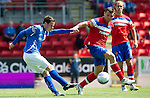 St Johnstone v Rangers... 30.07.11   SPL Week 2.Kevin Moon's shot is blocked by Lee McCulloch.Picture by Graeme Hart..Copyright Perthshire Picture Agency.Tel: 01738 623350  Mobile: 07990 594431