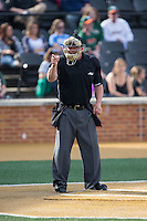 Home plate umpire David Savage makes a strike call during the ACC baseball game between the Miami Hurricanes and the Wake Forest Demon Deacons at Wake Forest Baseball Park on March 21, 2015 in Winston-Salem, North Carolina.  The Hurricanes defeated the Demon Deacons 12-7.  (Brian Westerholt/Four Seam Images)