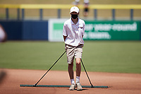 A member of the Kannapolis Cannon Ballers drags the infield between innings of the game against the Lynchburg Hillcats at Atrium Health Ballpark on August 29, 2021 in Kannapolis, North Carolina. (Brian Westerholt/Four Seam Images)