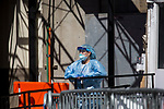 A health worker dressed in personal protective equipment (PPE) stands in front of a tent set up to screen for Covid-19 in front of the Brooklyn Hospital Center in the Brooklyn borough of New York, the United States, Thursday, April 2, 2020.   Worldwide coronavirus cases have surpassed 1,000,000.  Photograph by Michael Nagle