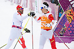 Sochi, RUSSIA - Mar 12 2014 -  Brian McKeever and his guide Graham Nishikawa win the gold medal in the Men's 1km Sprint Visually Impaired Final at the 2014 Paralympic Winter Games in Sochi, Russia.  (Photo: Matthew Murnaghan/Canadian Paralympic Committee)