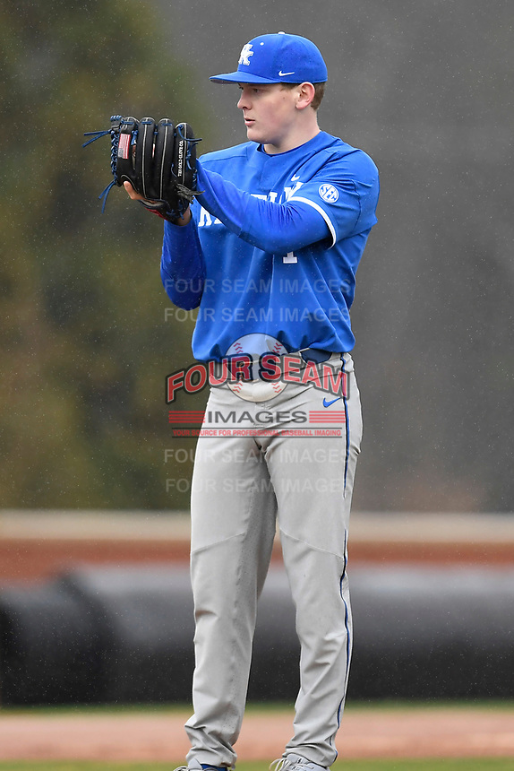 Starting pitcher Zack Thompson (14) of the Kentucky Wildcats pitches in a game in the rain against the University of South Carolina Upstate Spartans on Saturday, February 17, 2018, at Cleveland S. Harley Park in Spartanburg, South Carolina. Kentucky won, 6-5, in 10 innings. (Tom Priddy/Four Seam Images)