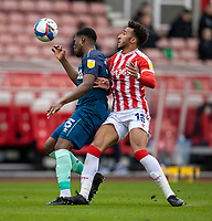 20th March 2021; Bet365 Stadium, Stoke, Staffordshire, England; English Football League Championship Football, Stoke City versus Derby County; Teden Mengi of Derby County holds off the challenge from Jacob Brown of Stoke City