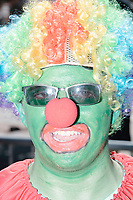 "Clayton Cresswell, of Pennsylvania, wore green face makeup and a clown wig as he marched in the Straight Pride Parade in Boston, Massachusetts, on Sat., August 31, 2019. The parade was organized in reaction to LGBTQ Pride month activities by an organization called Super Happy Fun America. Cresswell's makeup is likely a reference to a Clown Pepe The Frog meme which is common on the now-banned anti-Semitic subreddit Frenworld. Cresswell held a sign reading ""Make Normalcy Normal Again"" during portions of the parade."