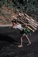 Child is carrying  heavy load in India.  Child labor as seen around the world between 1979 and 1980 - Photographer Jean Pierre Laffont, touched by the suffering of child workers, chronicled their plight in 12 countries over the course of one year.  Laffont was awarded The World Press Award and Madeline Ross Award among many others for his work.