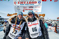 Kristy and Anna Berington pose at the finish line in Nome shorlty after finishing during the 2017 Iditarod on Thursday March 16, 2017.<br /> <br /> Photo by Jeff Schultz/SchultzPhoto.com  (C) 2017  ALL RIGHTS RESERVED