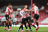 Brentford players congratulate Ethan Pinnock (No 5) after scoring their second goal during Brentford vs Charlton Athletic, Sky Bet EFL Championship Football at Griffin Park on 7th July 2020