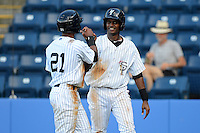 Staten Island Yankees second baseman Jose Rosario #21 and outfielder Daniel Lopez #51 after scoring runs during a game against the Connecticut Tigers on July 7, 2013 at Richmond County Bank Ballpark in Staten Island, New York.  Staten Island defeated Connecticut 6-2.  (Mike Janes/Four Seam Images)