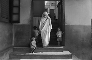 """Calcutta, India. April 04, 1975.<br /> Mother Teresa in her orphanage spending time with each of them. She takes long hours in the morning to talk and confront them. Mother Teresa (Agnes Gonxha Boyaxihu) the Roman Catholic, Albanian nun revered as India's """"Saint of the Slums,"""" was awarded the 1979 Nobel Peace Prize."""