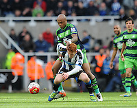 Andre Ayew of Swansea City fouls Jack Colback of Newcastle United during the Barclays Premier League match between Newcastle United and Swansea City played at St. James' Park, Newcastle upon Tyne, on the 16th April 2016
