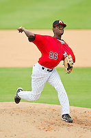Kannapolis Intimidators relief pitcher Euclides Leyer (26) delivers a pitch to the plate against the Lexington Legends at CMC-Northeast Stadium on July 31, 2013 in Kannapolis, North Carolina.  The Intimidators defeated the Legends 3-2.  (Brian Westerholt/Four Seam Images)
