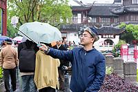 Nanjing, Jiangsu, China.  Young Chinese Man Taking a Selfie with a Selfie Stick.
