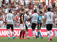 Calcio, Serie A: Roma vs Juventus. Roma, stadio Olimpico, 30 agosto 2015.<br /> Referee Nicola Rizzoli, second from right, shows a red card to Juventus' Giorgio Chiellini, third from left, during the Italian Serie A football match between Roma and Juventus at Rome's Olympic stadium, 30 August 2015.<br /> UPDATE IMAGES PRESS/Isabella Bonotto