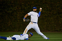 Chicago Cubs center fielder Jason Heyward (22) throws the ball in as Dexter Fowler (24) looks on from the ground in the seventh inning during Game 4 of the Major League Baseball World Series against the Cleveland Indians on October 29, 2016 at Wrigley Field in Chicago, Illinois.  (Mike Janes/Four Seam Images)