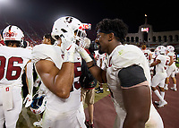 LOS ANGELES, CA - SEPTEMBER 11: Thomas Booker #4 celebrates with Stephen Herron #15 of the Stanford Cardinal in the final minutes of the fourth quarter during a game between University of Southern California and Stanford Football at Los Angeles Memorial Coliseum on September 11, 2021 in Los Angeles, California.