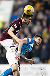 St Johnstone v Hearts…05.04.17     SPFL    McDiarmid Park<br />Krystain Nowak gets above Graham Cummins<br />Picture by Graeme Hart.<br />Copyright Perthshire Picture Agency<br />Tel: 01738 623350  Mobile: 07990 594431