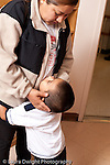 Education preschool 3-4 year olds separation mother and son saying goodbye vertical