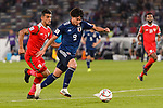 Minamino Takumi of Japan (R) is followed by Mohammed Al Musallami of Oman (L) during the AFC Asian Cup UAE 2019 Group F match between Oman (OMA) and Japan (JPN) at Zayed Sports City Stadium on 13 January 2019 in Abu Dhabi, United Arab Emirates. Photo by Marcio Rodrigo Machado / Power Sport Images