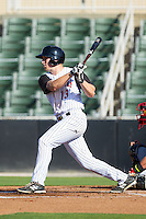 Carl Thomore (13) of the Kannapolis Intimidators follows through on his swing against the Hickory Crawdads at CMC-Northeast Stadium on May 4, 2014 in Kannapolis, North Carolina.  The Intimidators defeated the Crawdads 3-1.  (Brian Westerholt/Four Seam Images)