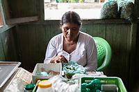 """A female coca grower known as """"cocalero"""", merchandises coca leaves' in plastic bags for chewing, called in Quechua language """"picchear"""", beside a highway in Entre Rios town, Chapare region, Bolivia. December 01, 2019.<br /> Une cultivatrice de coca connue sous le nom de """"cocalero"""", commercialise des feuilles de coca dans des sacs en plastique à mâcher, appelés en langue quechua """"picchear"""", le long d'une autoroute à Entre Rios, région du Chapare, Bolivie. 01 décembre 2019."""