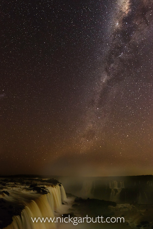 The Milky Way, night sky at Iguasu Falls (also Iguazu Falls, Iguazú Falls, Iguassu Falls or Iguaçu Falls) on the Iguasu River, Brazil / Argentina border. Photographed from the Brazilian side of the Falls. State of Paraná, Brasil.