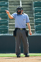 Home plate umpire Aaron Reynolds calls a strike during the South Atlantic League game between the Hagerstown Suns and the Kannapolis Intimidators at Fieldcrest Cannon Stadium on May 30, 2011 in Kannapolis, North Carolina.   Photo by Brian Westerholt / Four Seam Images