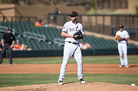 Salt River Rafters relief pitcher Mitch Horacek (32), of the Colorado Rockies organization, gets ready to deliver a pitch during an Arizona Fall League game against the Glendale Desert Dogs at Salt River Fields at Talking Stick on October 31, 2018 in Scottsdale, Arizona. Glendale defeated Salt River 12-6 in extra innings. (Zachary Lucy/Four Seam Images)