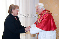 Chile's President Michelle Bachelet Jeria poses with Pope Benedict XVI during a private audience at the Vatican on November 28, 2009