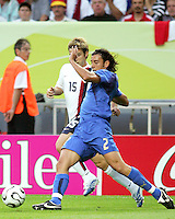 Cristian Zaccardo of Italy gets the ball off Bobby Convey of the USA. The USA and Italy played to a 1-1 tie in their FIFA World Cup Group E match at Fritz-Walter-Stadion, Kaiserslautern, Germany, June 17, 2006.
