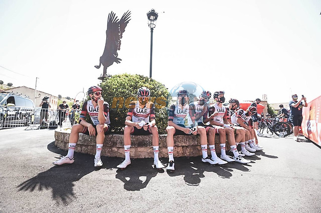 UAE Team Emirates riders relax before the start of Stage 2 of La Vuelta d'Espana 2021, running 166.7km from Caleruega. VIII Centenario de Santo Domingo de Guzmán to Burgos. Gamonal, Spain. 15th August 2021.    <br /> Picture: Unipublic/Charly Lopez | Cyclefile<br /> <br /> All photos usage must carry mandatory copyright credit (© Cyclefile | Unipublic/Charly Lopez)