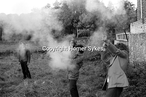Tar Barrel Rolling. Ottery St Mary, Devon, England  1973. Firing rock cannons. Small gun like instruments. Annually November 5th.
