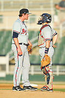 Rome Braves catcher Tyler Tewell (9) has a chat on the mound with relief pitcher Tyler Brosius (40) during the South Atlantic League game against the Kannapolis Intimidators at CMC-Northeast Stadium on August 25, 2013 in Kannapolis, North Carolina.  The Intimidators defeated the Braves 9-0.  (Brian Westerholt/Four Seam Images)