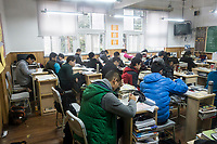 Students sit for a class at the prestigious Shanghai High School in Shanghai, China on 27 February, 2014.  As one of the most demanding and exclusive high school in the country, Shanghai High School puts grueling study hours on its students, academic studies often last from 6:45 Am to as late as 9 PM.
