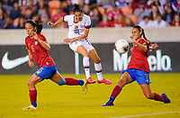 HOUSTON, TX - FEBRUARY 03: Christen Press #20 of the United States scores on a blistering shot past Costa Ricans Carol Sanchez #6 and Maria Paula Coto #3 during a game between Costa Rica and USWNT at BBVA Stadium on February 03, 2020 in Houston, Texas.