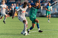 HARTFORD, CT - JULY 10: Omar Sowe #67 of New York Red Bulls II on the attack as Thomas Janjigian #20 of Hartford Athletic defends during a game between New York Red Bulls II and Hartford Athletics at Dillon Stadium on July 10, 2021 in Hartford, Connecticut.