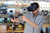 Nathan Morris of Mike-O-Soft Computers in Swansea Market tests out his HTC virtual reality gear. 16 June 2016