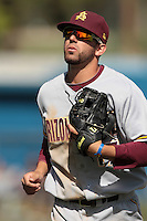 Deven Marrero #17 of the Arizona State Sun Devils returns to the dugout during a game against the Long Beach State Dirtbags at Blair Field on March 11, 2012 in Long Beach,California. Arizona State defeated Long Beach State 6-1.(Larry Goren/Four Seam Images)