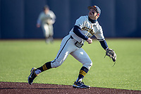 Michigan Wolverines second baseman Riley Bertram (12) on defense during the NCAA baseball game against the Illinois Fighting Illini at Fisher Stadium on March 19, 2021 in Ann Arbor, Michigan. Illinois won the game 7-4. (Andrew Woolley/Four Seam Images)