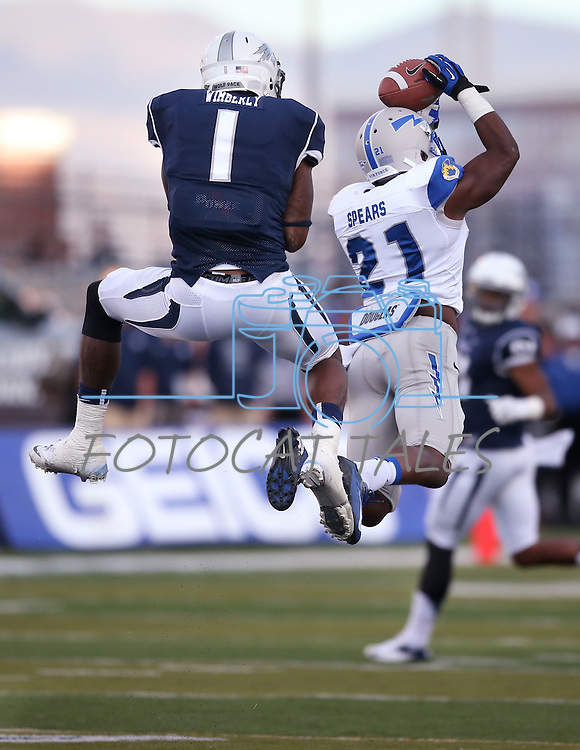 Air Force defender Christian Spears tries to make an interception off Nevada's Brandon Wimberly during the first half of an NCAA football game in Reno, Nev., on Saturday, Sept. 28, 2013. <br /> Photo by Cathleen Allison