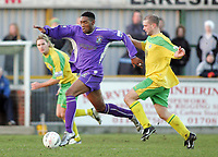 Thurrock vs Grays Athletic - 26/12/04 - Nationwide Conference South - Grays' opening scorer Dennis Oli strides away from Thurrock's  Adam Parker - (Gavin Ellis)