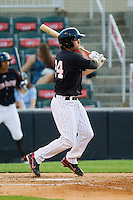Patrick Palmeiro (24) of the Kannapolis Intimidators follows through on his swing against the Hagerstown Suns at CMC-Northeast Stadium on May 17, 2013 in Kannapolis, North Carolina.  The Suns defeated the Intimidators 9-7.   (Brian Westerholt/Four Seam Images)