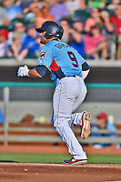 Tennessee Smokies second baseman Anthony Giansanti #9 runs to first during a game against the Birmingham Barons at Smokies Park on May 31, 2014 in Kodak, Tennessee. The Barons defeated the Smokies 2-1. (Tony Farlow/Four Seam Images)