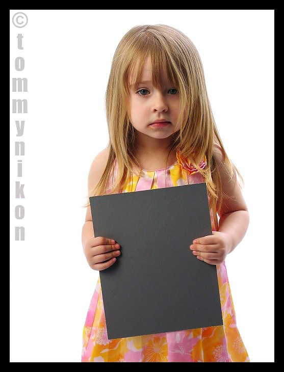 Child of model on the set; to occupy her and placate her mom, I had her model for the light test.