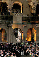 Suore portano la croce durante la Via Crucis presieduta dal Papa al Colosseo, Roma, 3 aprile 2015.<br /> Nuns hold the cross during the Via Crucis (Way of the Cross) torchlight procession attended by the Pope, at the Colosseum, Rome, 3 April 2015.<br /> UPDATE IMAGES PRESS/Riccardo De Luca<br /> <br /> STRICTLY ONLY FOR EDITORIAL USE