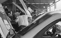 Crewmen work on race cars in the garage, Winston 500 at Alabama International Motor Speedway in Talladega, AL on May 1, 1983.  (Photo by Brian Cleary/www.bcpix.com)