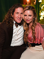 BEVERLY HILLS - JANUARY 5: (L-R) THE POLITICIAN Executive Producer Ian Brennan and Trilby Glover attend The Walt Disney Company 2020 Golden Globe Awards Nominee Celebration at The Disney Terrace on the Roof Deck at the Beverly Hilton on January 5, 2020 in Beverly Hills, California. (Photo by Frank Micelotta/The Walt Disney Company/PictureGroup)