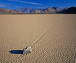 Death Valley National Park, CA<br /> Tile patterns of the Racetrack playa - a dried lakebed -  with a windblown rock and path